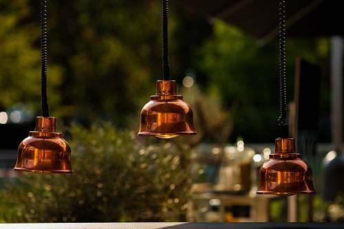copper photo of brown 3-bulb pendant lamps lamp