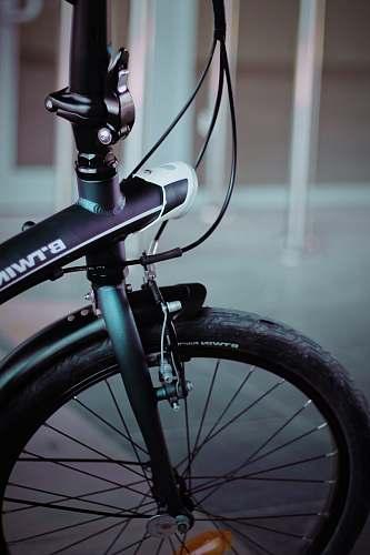 wheel black and gray bike near bars transportation