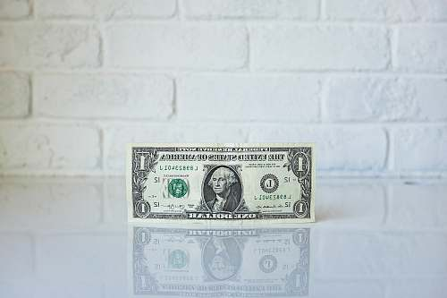 equity 1 U.S. dollar banknote on white surface dollar