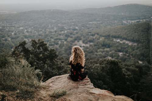 nature woman siting on cliff female