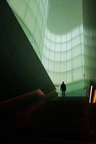 photo milano man walking on stair inside building italy free for commercial use images