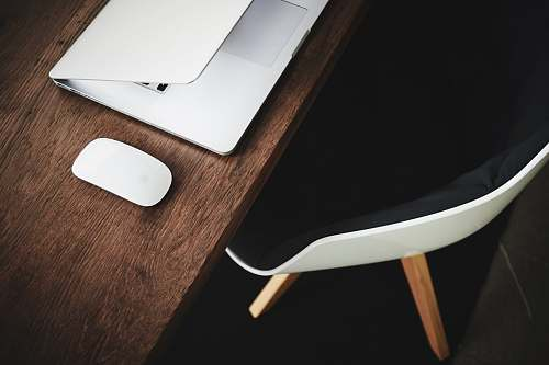 workspace white Apple Magic mouse on brown table furniture