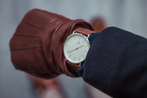 netherlands person looking at round white analog watch at 10:22 watch