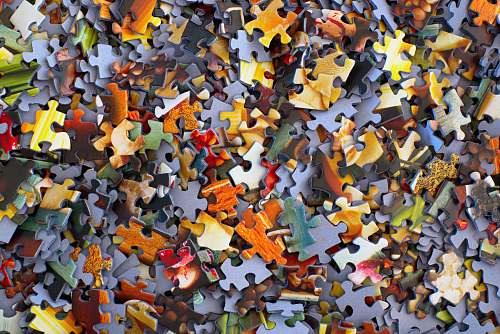 photo texture stack of jigsaw puzzle pieces confetti free for commercial use images