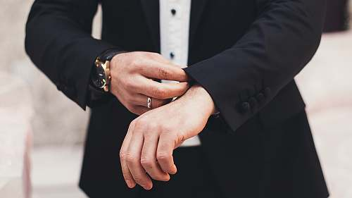 business A man's hands adjusting the cuffs of his black suit azerbaijan