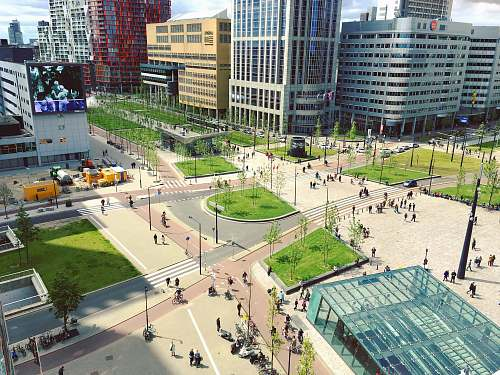rotterdam aerial photography of people walking on park near city buildings aerial view