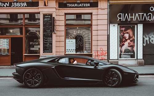 human black Lamborghini on the street person