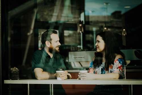 coffee couple drinking coffee inside coffee shop human