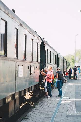 train people riding train transportation