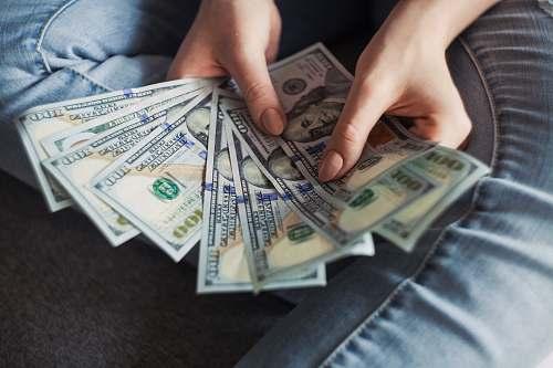 money fan of 100 U.S. dollar banknotes banking