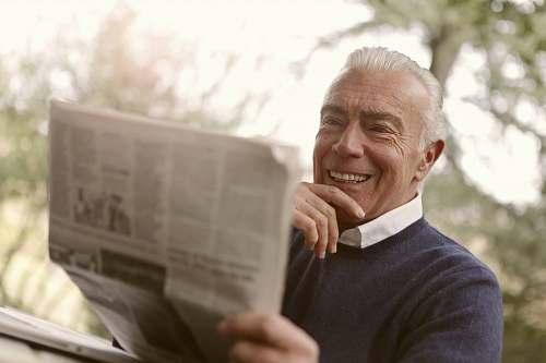 human man reading newspaper newspaper