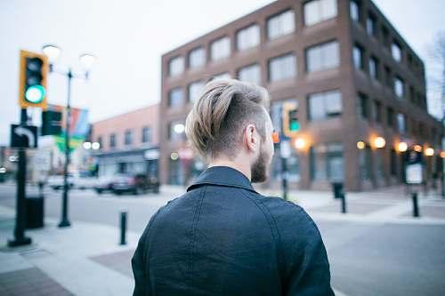 people man standing on street human