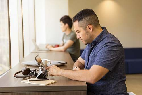 human man touching tablet computer on desk people