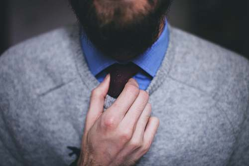 human man wearing gray sweater people