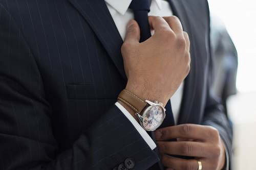 human man wearing watch with black suit people