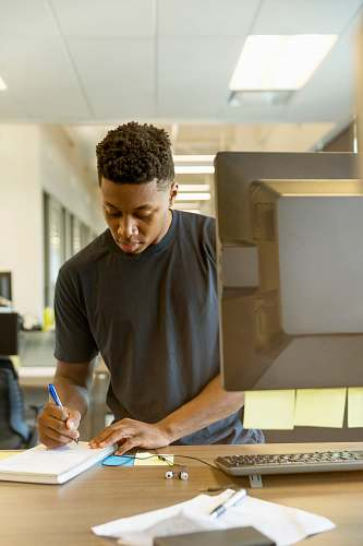 people man writing on white paper human