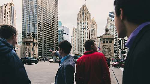 human men standing near road people