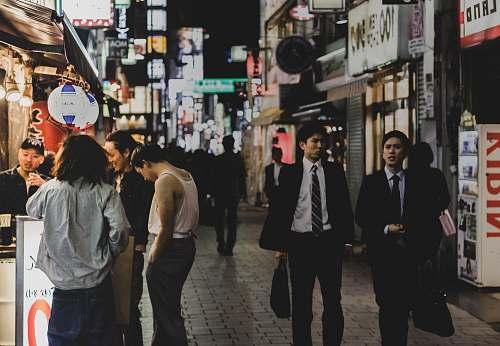 human people on street during night people