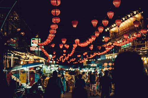 people people walking between food stalls under chinese lanterns vietnam