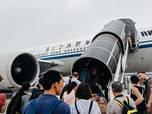 human people walking towards airplane during daytime vehicle
