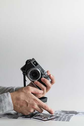 human person holding camera people