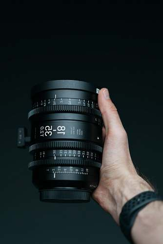 human person holding camera lens camera
