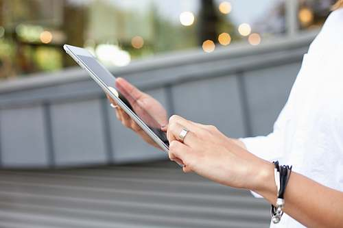 human person holding iPad electronics