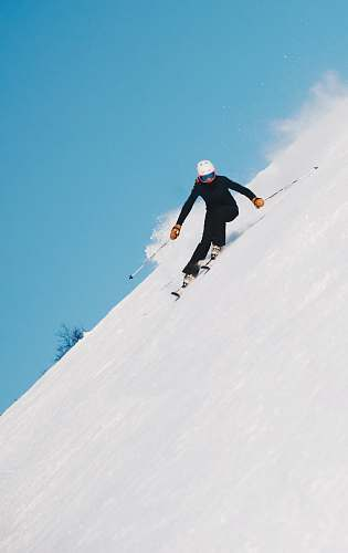 human person skiing on snow with gear set people