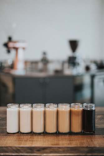 human selective focus photography of glass with liquid in it coffee