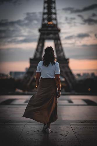 human woman standing in front of Eiffel tower people