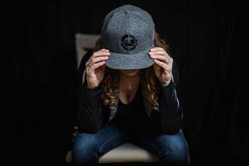 apparel woman wearing gray cap clothing