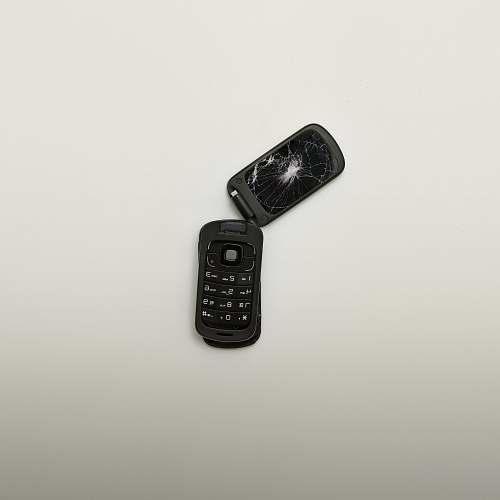 screen broken black flip phone \ isolated
