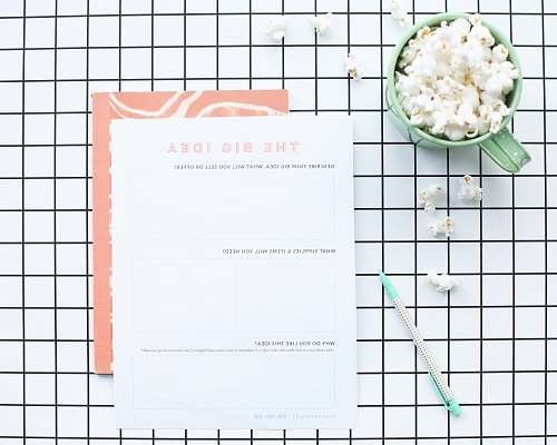 food white printer paper near green ceramic mug vegetable