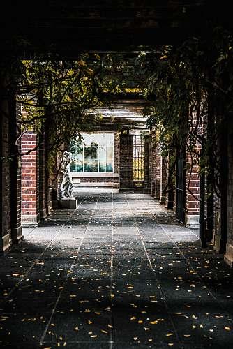 patio brown brick hallway corridor