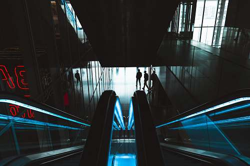 photo netherlands person standing near empty escalator blue free for commercial use images