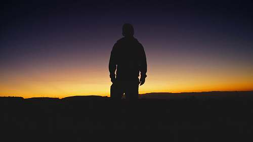 human silhouette of man during sunset people