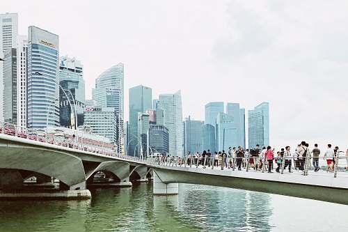 bridge people waking on bridge during daytime building