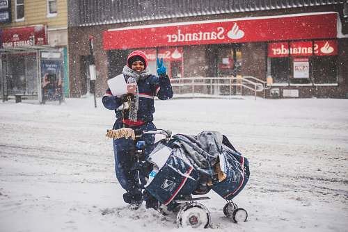 winter person standing beside stroller storm