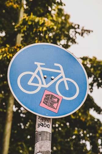 blue bike lane signage road sign