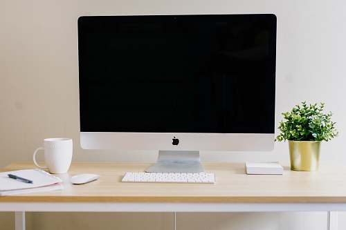 furniture silver iMac, Apple Magic Keyboard, and Apple Magic Mouse desk