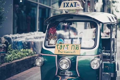 asia green auto rickshaw taxi