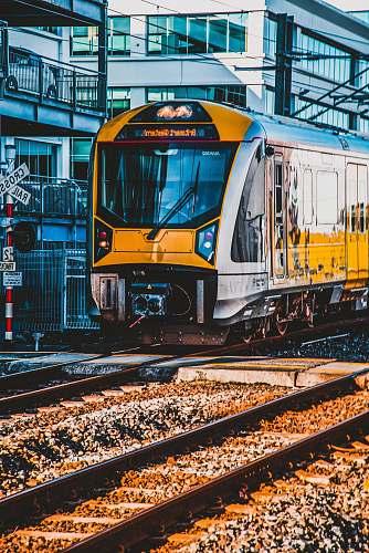 transportation yellow, black and gray train vehicle