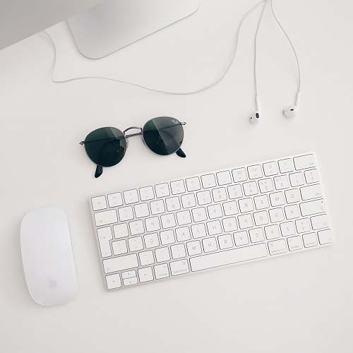 desk Apple Magic keyboard and mouse white