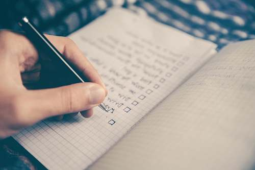 planning person writing bucket list on book text