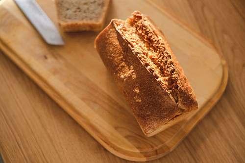 food bread on chopping board bread loaf