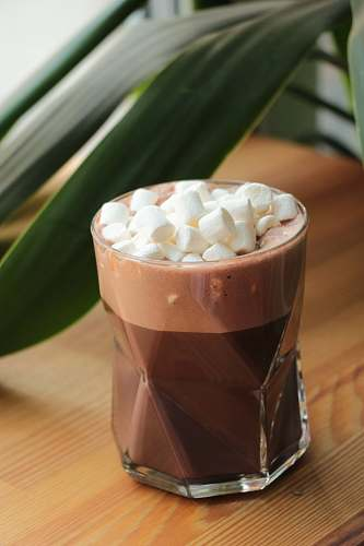 dessert chocolate with marshmallows on top in drinking glass drink