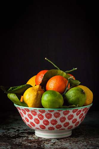 food orange and green fruits on bowl fruit