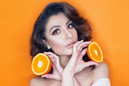 food woman holding orange fruits fruit