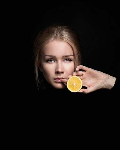 food woman holding slice of orange fruit fruit