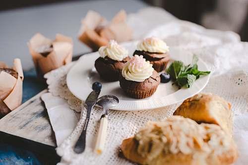 food chocolate cupcakes on white ceramic plate cream